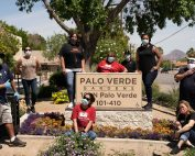 six women standing around the palo verde gardens sign.