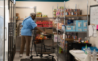 African american woman shopping in the Food Pantries at Senior Communities