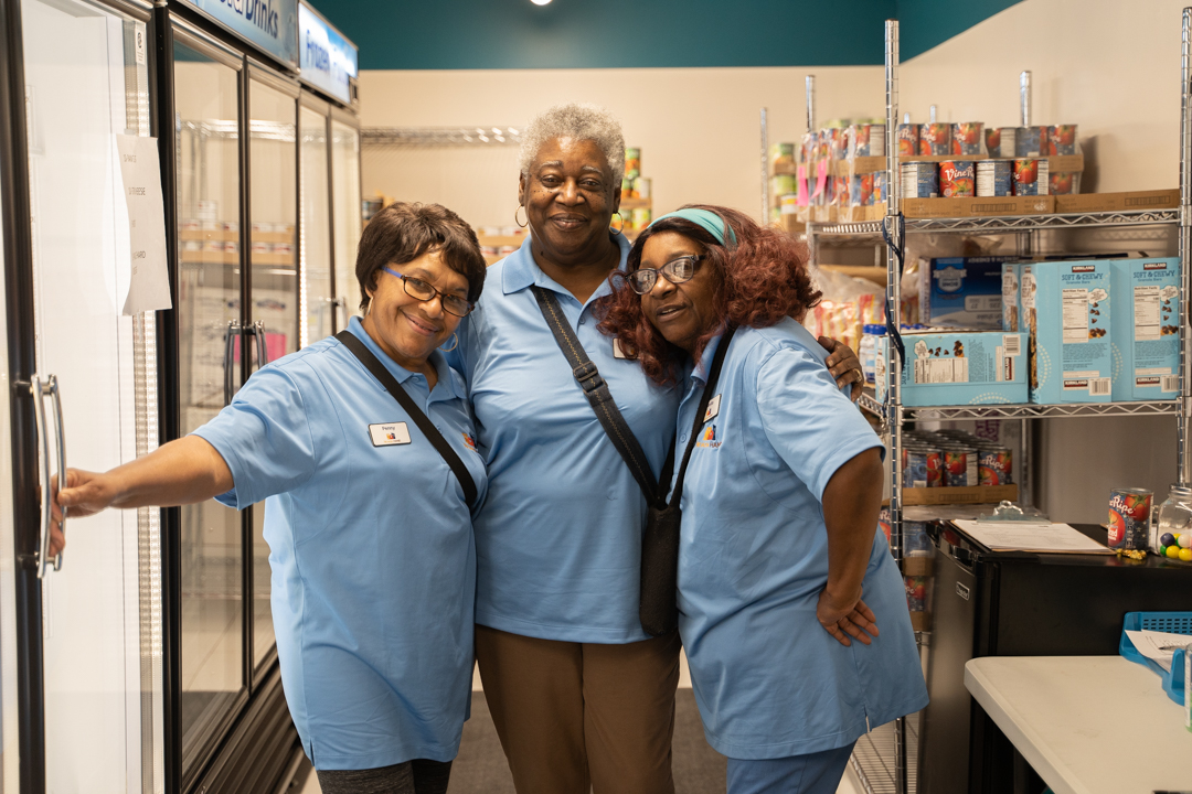 three african american woman posing for a picture in the Food Pantries at Senior Communities