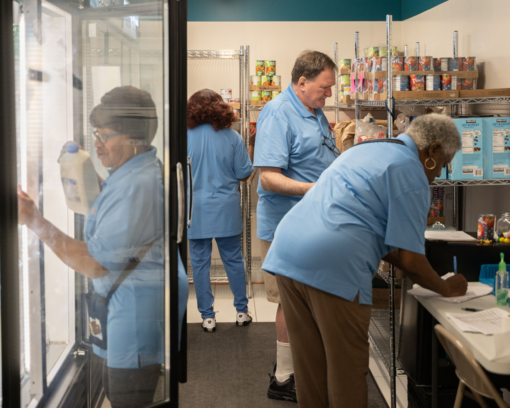 Food Pantries at Senior Communities 3 African american women and one caucasian female working in the pantry.