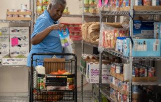 African american woman shopping in Food Pantries at Senior Communities